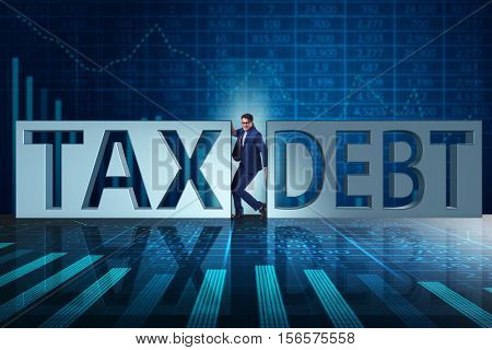 Businessman in tax and debt concept