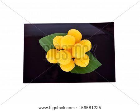 Thai dessert Thong-Yot (egg yoke fudge balls cooked in syrup) on plate