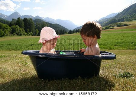 two baby washing