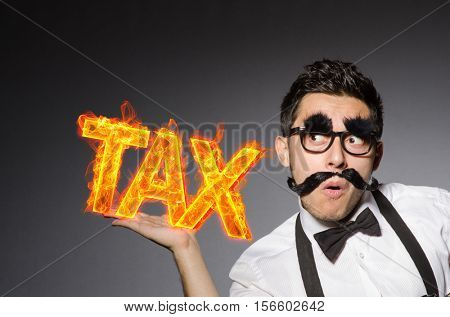 Funny businessman in tax business concept
