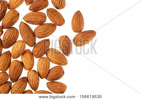 Nuts border of almonds on white background. Pile of selected almond close-up. Isolated. For vegetarians.
