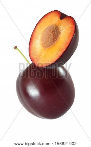 hanging falling hovering and flying whole and sliced plum isolated on white background with clipping path