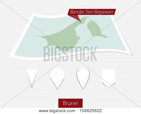 Curved Paper Map Of Brunei With Capital Bandar Seri Begawan On Gray Background. Four Different Map P