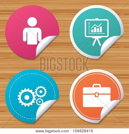 Round stickers or website banners. Business icons. Human silhouette and presentation board with charts signs. Case and gear symbols. Circle badges with bended corner. Vector