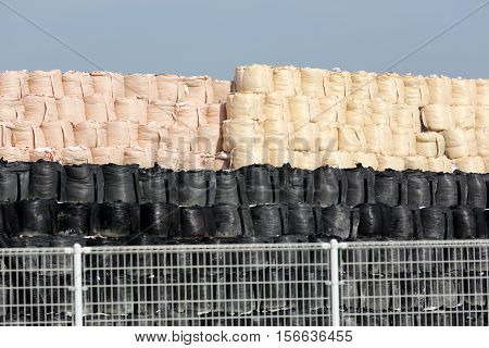 stack of toxic substance bag with a blue sky background