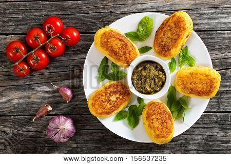 Potato Pancakes Stuffed With Chicken Meat On White Plate