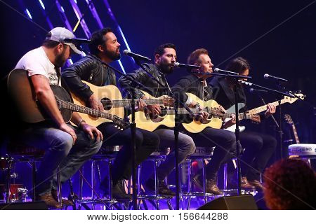 CHICAGO-NOV 9: Tyler Farr (L) and Old Dominion perform at CBS Radio's Stars & Stripes event at the Chicago Theatre on November 9, 2016 in Chicago, Illinois.