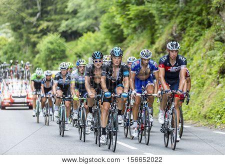 Col du Tourmalet France - July 242014: The peloton climbing the road to Col de Tourmalet in the stage 18 of Le Tour de France 2014.