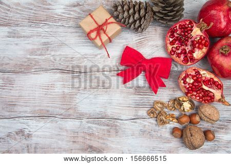 Christmas Background With Ripe Pomegranate And Traditional Ornaments