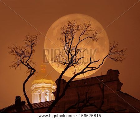 Supermoon, a rare astronomical full moon phenomenon. Moon is bigger as normal in the sky. Mist, photo illustration with double exposure.