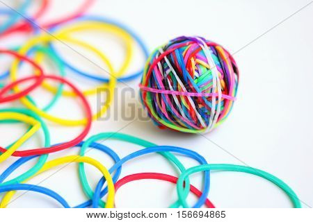 Colorful rubber band ball on white background