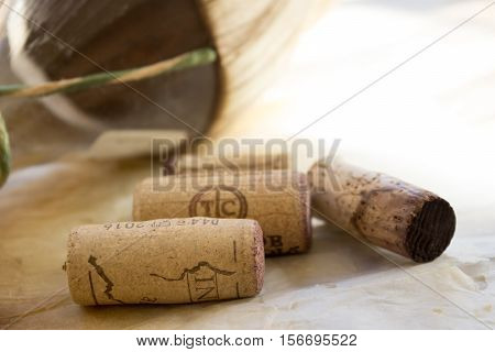 flask of aged red wine with corks