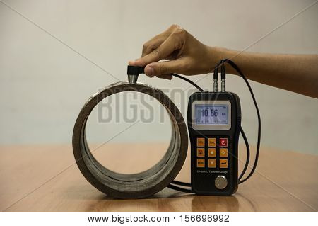 Inspection wall thickness pipe by ultrasonic thickness test for found internal defect. UTM