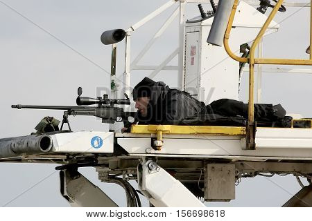 A Sniper Aims His Weapon Securing The Area As President Barack Obama