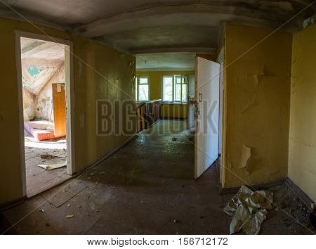 Abandoned destroyed house destroyed interior stripped the walls of the house to be demolished