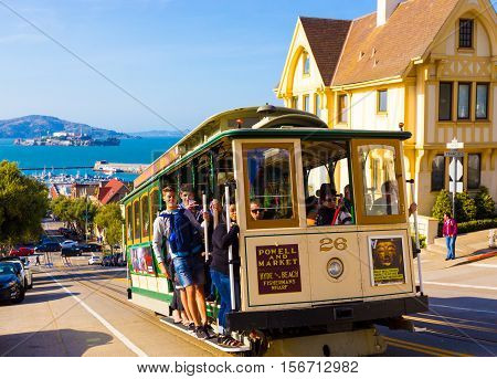Closeup Passengers Riding Sf Cable Car Alcatraz