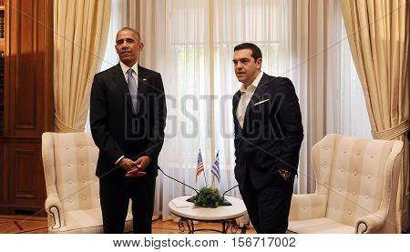 Greek Prime Minister Alexis Tsipras, Right, Speaks With U.s. President Barack Obama