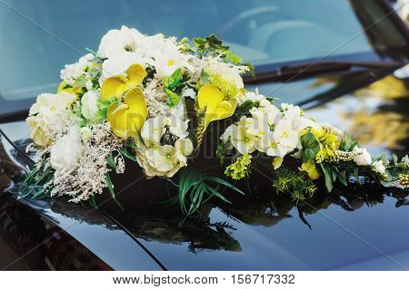 Wedding Decoration With Flowers On The Black Car