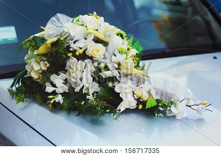 Wedding Decoration With Flowers On The White Car