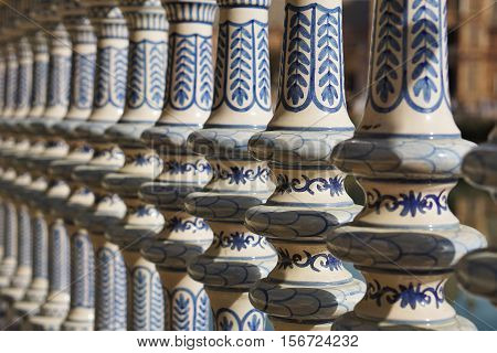 Detail of a ceramic decorated railing (handrail) in Sevilla (Seville) in Southern Spain in front of the famous Plaza de Espana