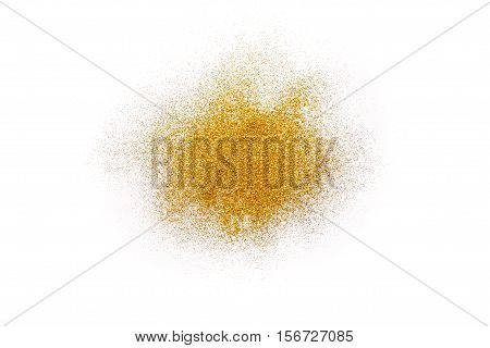 Golden glitter sand texture handful spread on white, abstract background with copy space. Yellow dusty shimmer decoration pile, shiny and sparkling. Holidays and glamour concept.