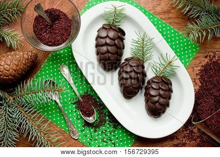 Christmas treats chocolate cake shaped pinecone top view