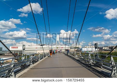 Krasnogorsk, Russia - July 09.2016 People go on the cable-stayed pedestrian bridge.