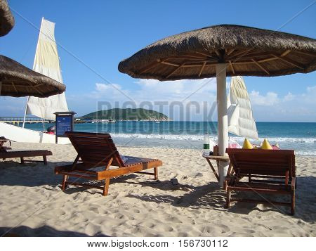 Sunbeds on Beach with white sand on island