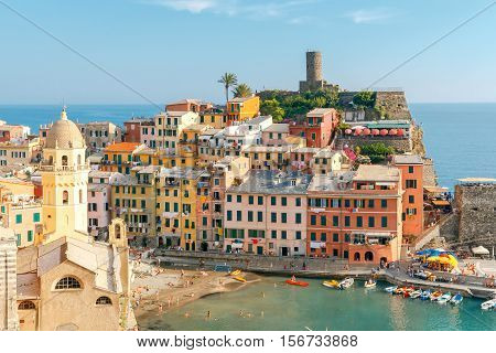 The view from the high hill village of Vernazza and the old harbor at sunset. Cinque Terre National Park. Liguria. Italy.
