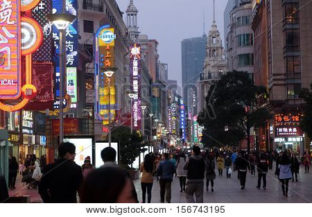 SHANGHAI - FEBRUARY 29. Neon signs lit on Nanjing Road. The area is the main shopping district in Shanghai city and one of the world's busiest shopping streets in Shanghai, China, February 29, 2016.
