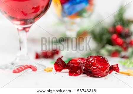 Close Up Of Wine And Sweets On A Christmas Table.