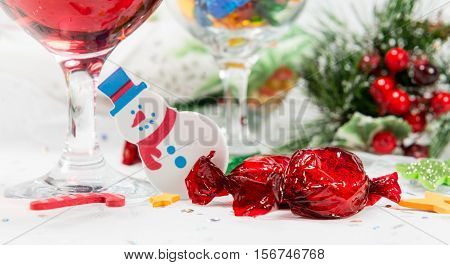 Snowman Decoration, Wine And Sweets On A Christmas Table.