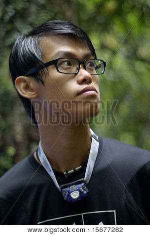 Slick hair asian man outdoors
