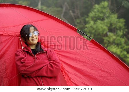 Asian malay teen girl outside red tent