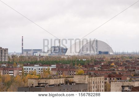Chernobyl exclusion zone. Empty abandoned Pripyat city. View on fourth power generating unit with new cover confinement. Zone of high radioactivity. Chernobul. Ukraine..