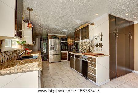 Kitchen Room In Brown Tones With Storage Combination