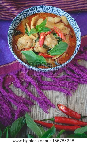 Thai Chicken Red Curry on Thai Fabric and Old Wooden Background Thai Food Thai Cuisine Thai Famouse Food