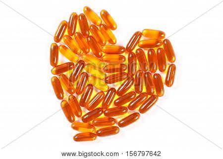 Heart Shaped Medical Pills And Capsules On White Background, Health Care Concept