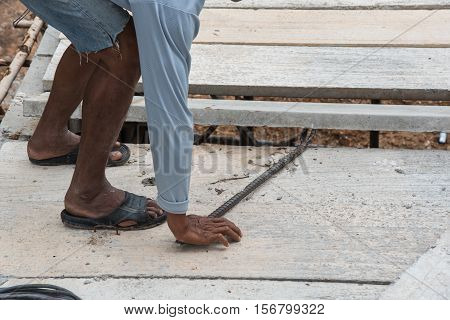 Builder worker man installing cement floor slab panel at building construction site