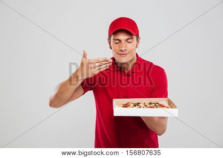 Pizza delivery boy. isolated gray background