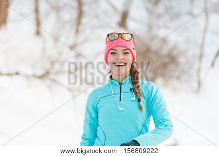 Girl Has Fun Throwing Snowballs
