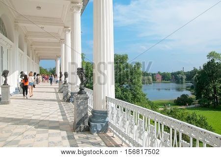 TSARSKOYE SELO, SAINT - PETERSBURG, RUSSIA - JULY 25, 2016: The Cameron Gallery. The bronze busts of the Antique deities, heroes and great names of history. On the background is The Admiralty Pavilion