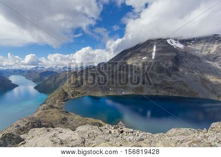Beseggen ridge in norway with blue sky and clouds