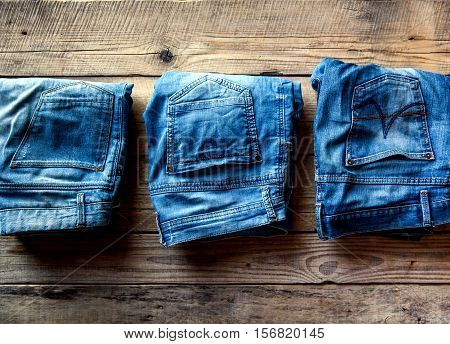 Blue Jeans On Wooden Board. Color Jeans Fashion.