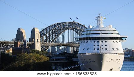 Sydney Australia - October 24 2016: Sydney Harbour Bridge and a cruise ship mooring in Sydney Cove in Sydney Australia.