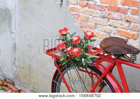 flower close up on saddle red bicycle classic vintage