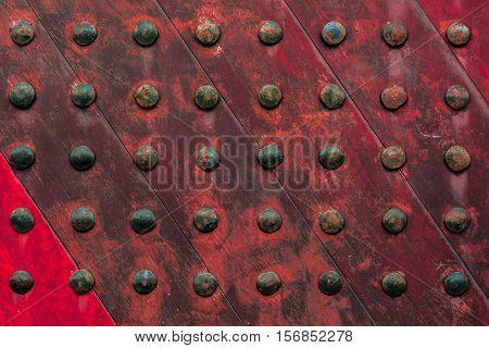 red ancient wooden door texture background.,Close up of wooden door