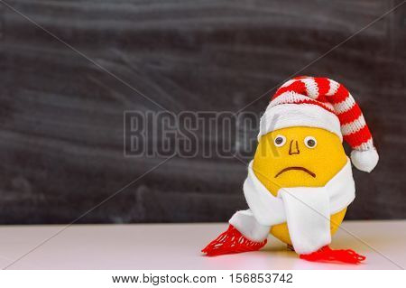 lemon striped hat and scarf with a sad face