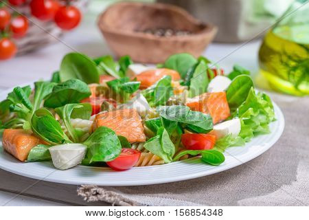 Closeup Of Homemade Salad With Salmon And Vegetables