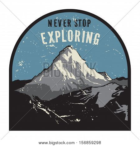 Mountains badge or emblem. Adventure outdoor expedition mountain badge climbing mountain snowy peak mountain label with text Never Stop Exploring vector illustration
